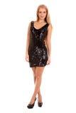 Schöne blonde Frau im schwarzen glänzenden Kleid Lizenzfreie Stockfotografie