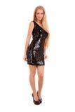 Schöne blonde Frau im schwarzen glänzenden Kleid Lizenzfreies Stockbild