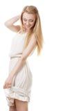 Schöne blonde Frau mit dem langen Haar auf Weiß Lizenzfreie Stockbilder
