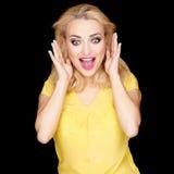 Schöne blonde Frau mit einem überraschten Ausdruck Stockfotografie