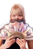 Schöne blonde Frau mit einem Gebläse Lizenzfreie Stockbilder