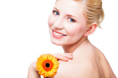 Schöne blonde Frau mit einer Blume Lizenzfreies Stockbild