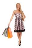 Schöne blonde Frauenholding-Einkaufenbeutel Lizenzfreies Stockfoto