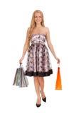 Schöne blonde Frauenholding-Einkaufenbeutel Stockfoto