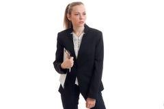 Schöne blonde Geschäftsfrau in der klassischen Uniform Stockfotos