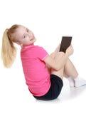 Schöne blonde Jugendliche in einem roten T-Shirt und Stockfotos