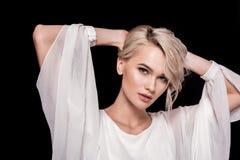 schöne blonde junge Frau, lokalisiert Stockfotos