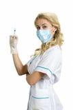 Schöne blonde Krankenschwester mit Spritze Lizenzfreies Stockbild