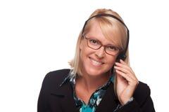 Schöne blonde Kundenbetreuungs-Frau mit Köpfen Lizenzfreie Stockfotografie