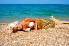 Schöne blonde Meerjungfrau Stockfotografie