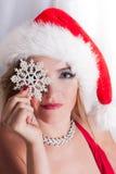 Schöne blonde Sankt mit Schneeflocke Stockfotografie