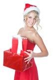 Schöne blonde Weihnachtsfrau mit Geschenken Stockbild