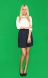 Schöne Blondine in einem Kleid Stockbild