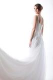 Schöne Braut in einem luxuriösen Hochzeitskleid Stockfotografie