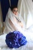 Schöne Braut an ihrem Hochzeitstag. Stockfoto