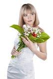 Schöne Braut mit dem Blumenstrauß getrennt auf Weiß Stockfoto