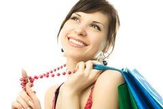Schöne Brunettefrau mit Einkaufenbeuteln Stockfoto