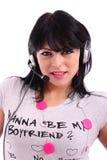 Schöne Brunettefrau mit Kopfhörer Lizenzfreies Stockfoto
