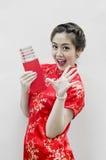 Schöne chinesische Frau mit Traditionkleidung Stockbilder