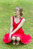 Schöne Dame im Rot Stockfoto