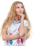 Schöne durchdachte blonde Frau, die oben schaut Stockbild