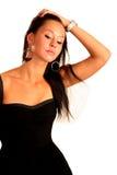 Schöne elegante Frau behebt Haar Lizenzfreies Stockbild