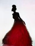 Schöne elegante Frau im Luxusabendkleid Stockbild