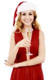 Schöne elegante Frau im roten Kleid mit einem Glas Champagner c Lizenzfreie Stockfotos