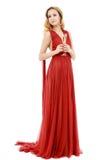 Schöne elegante Frau im roten Kleid mit einem Glas Champagner c Stockfoto