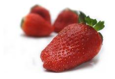 Schöne Erdbeeren getrennt auf Weiß Lizenzfreies Stockbild