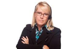 Schöne ernste blonde Kundenbetreuungs-Frau Lizenzfreie Stockbilder