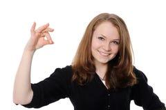 Schöne Frau, die leeren weißen Vorstand anhält Stockfoto