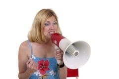 Schöne Frau, die mit Megaphon 3 verweist Stockbild