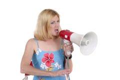 Schöne Frau, die mit Megaphon 4 verweist Lizenzfreie Stockfotos