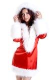 Schöne Frau, die Weihnachtsmann-Kleidung trägt Stockfoto