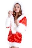 Schöne Frau, die Weihnachtsmann-Kleidung trägt Stockbild