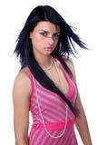Schöne Frau in einem rosafarbenen Kleid Stockfotografie