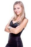 Schöne Frau in einem schwarzen Kleid Stockbild