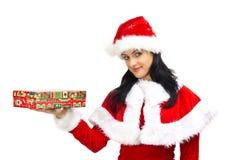 Schöne Frau kleidete in Weihnachtsmann an Lizenzfreies Stockbild