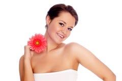 Schöne Frau mit Blume lizenzfreie stockbilder