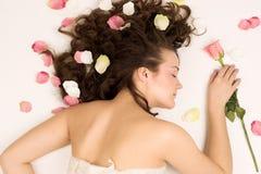 Schöne Frau mit Blume Lizenzfreie Stockfotos