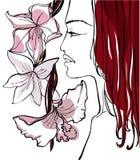 Schöne Frau mit Blumen Stockfotografie