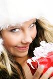 Schöne Frau mit einem Geschenk Stockbild