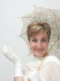Schöne Frau mit fantastischem Regenschirm lizenzfreies stockbild