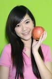 Schöne Frau mit Frucht Stockbild