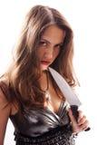 Schöne Frau mit großem Messer Stockfotografie