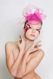 Schöne Frau mit hellem Gesichtskunst-Antlitz Stockfoto