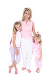 Schöne Frau mit ihren Töchtern über Weiß Stockbilder