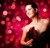 Schöne Frau mit Karnevalsschablone Stockbilder
