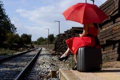 Schöne Frau mit Regenschirm Stockfotos